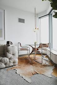 Corner Dining Room by Corner Dining Space With Cowhide Rug Transitional Dining Room