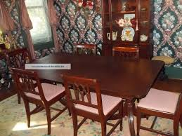 mahogany dining room table and 8 chairs six 360 degree swivel