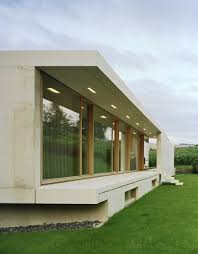 the one storey slightly inclined modern house overlooking the alps