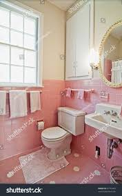 dated bathroom pink tile white wood stock photo 81774463