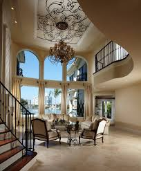 double height ceiling living room mediterranean with seating area