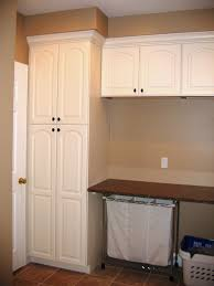 interior laundry room shelves and storage with brown wooden
