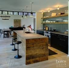 interesting kitchen islands modern and rustic blended transom windows wood shelving on all