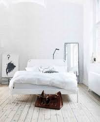Minimalist Bed White Minimalist Bedroom With White Bedding And Floor Mirror