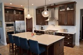 black kitchen cabinets with white subway tile backsplash kitchen with cabinets white countertops and white