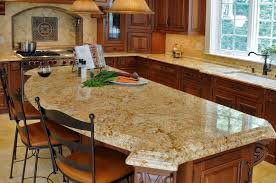 granite countertop yellow kitchen dark cabinets tile backsplash