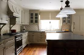 cream kitchen cabinets with soapstone countertops transitional