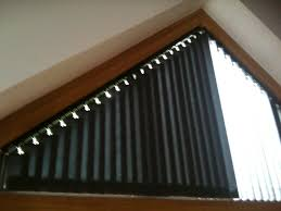 part closed blinds in triangular window triangular window