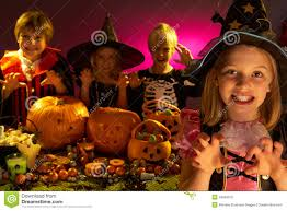 halloween party with children wearing costumes royalty free stock