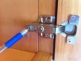 kitchen cabinet roll up door repair