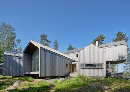 murman arkitekter completes a waterfront swedish villa
