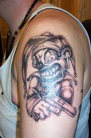 collection of 25 scary joker n cards on arm