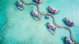 soneva jani maldives most luxurious overwater bungalow flying