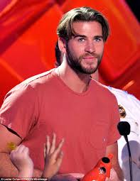 mans old fashion haircut parted down middle liam hemsworth debuts cringe inducing middle part mushroom