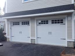 installation of garage door c h i overhead doors model 5916 long panel steel carriage house