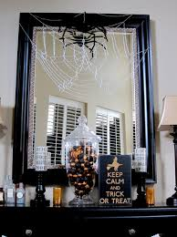 halloween decorations spiders web to spook up everyone spider decor on mirror in living room