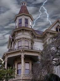 Victorian Time by Stern Looking Victorian Mansion Weathers A Lightening Storm In