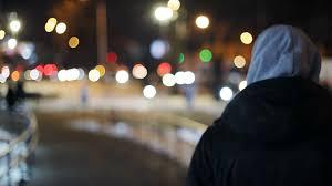 light for walking at night back view young man hood walking night street smoking cigarette