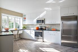 White Kitchen Cabinets With Black Granite Contemporary Kitchen With Limestone Tile Floors By Paquin