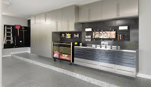 garage makeover prestige garage ny nj ct quality floor there s a place for every tool in this homeowner s garage is this custom garage storage solution on your wish list for your orlando homes