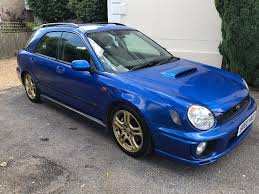 subaru hatchback wrx subaru impreza wrx wagon wrc blue with iconic gold wheels in