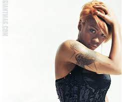 kesha cole showing some skin and tattoos photo on blastro