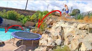 backyard cliff jump to trampoline into pool 20ft gap youtube