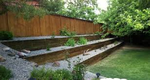 backyard landscaped with railroad ties outside landscaping with