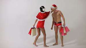 santa uplifting man gives him a christmas gift close up a
