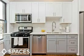 white shaker kitchen cabinets with gray quartz countertops 4337 49 n hazel 3f construction