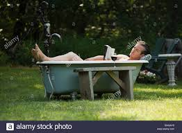 outdoor bathtub man in outdoor bathtub stock photo royalty free image 28019348