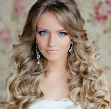 long curly prom hairstyles with side swept bangs