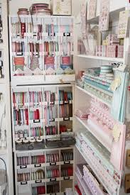 fabric and ribbon storage in a craft store 24 creative craft room