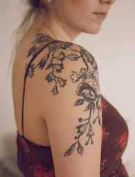 got inked beautifully on shoulder with flowers and vines
