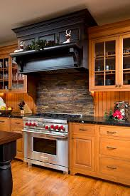 Rock Backsplash Kitchen by Stacked Stone Backsplash Kitchen Eclectic With Bamboo Cabinets
