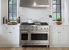 white kitchen cabinets and black stainless steel appliances 4 kitchen color schemes to try with stainless steel