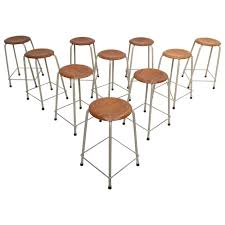 ten stackable dutch industrial university lab stools by ahrend