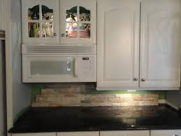 unique mini stacked stone backsplash with simple lighting design