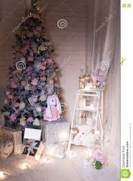pink christmas tree at the white brick wall background stock