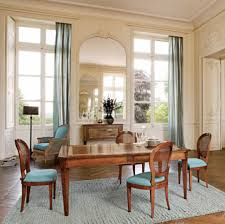 dining room a decorative patterned dining room wall mirrors in a