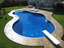 images of garden landscaping with kidney shaped pool back