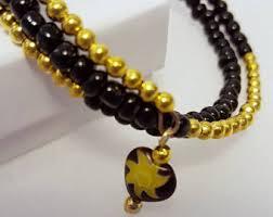black bracelet with gold images Black gold bracelet etsy jpg