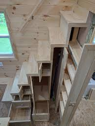 tiny house stairs with storage shelves and pantry tinyhome io