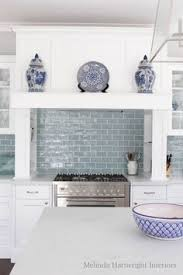 kitchen tiles for backsplash this is it white cabinets white counters open shelves chrome