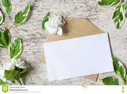 blank greeting card and envelope with flowers stock photo