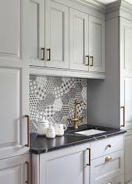 gray kitchen cabinets with honed black marble countertops