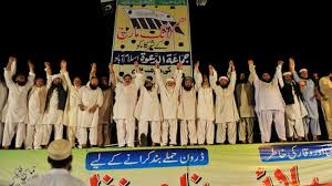 Anti-NATO long march reaches Islamabad. Leaders of the Defense of Pakistan Council raise their hands in a show of solidarity during a protest march in ... - jammas.hussain20120709214403543