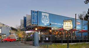 cantilevered shipping container coffee shop pops up in