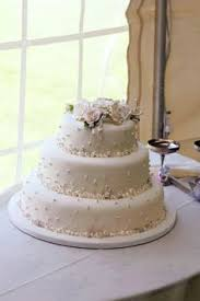 a awesome idea is to use small wedding cakes at each table that