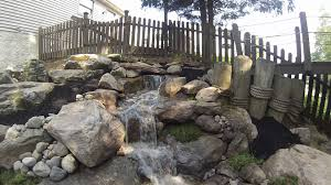pondless waterfall natural stone steps boulder retaining wall
